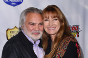 """Jane Seymour and friend David Green attend the Los Angeles premiere of """"Running Wild"""" at the Chinese 6 Theatre in Hollywood, on February 6, 2017. / AFP / CHRIS DELMAS"""