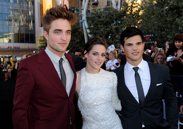 """Kristen Stewart (L-R) Actors Robert Pattinson, Kristen Stewart and Taylor Lautner arrive at the premiere of Summit Entertainment's """"The Twilight Saga: Eclipse"""" during the 2010 Los Angeles Film Festival at Nokia Theatre L.A. Live on June 24, 2010 in Los Angeles, California."""