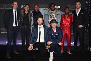 """(i-r) Front Row: Actor Jimmi Simpson, director Anthony Hemmingway, Back Row: creator/executive producer Kyle Long, executive producer Mark Taylor, actors Bokeem Woodbine, Wavyy Jonez, Marcc Rose and Josh Duhamel attend the premiere of USA Network's """"Unsolved: The Murders of Tupac and The Notorious B.I.G. at Avalon on February 22, 2018 in Hollywood, California."""