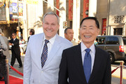 Actor George Takei (R) and Brad Altman arrives at the Premiere of Universal Pictures' 'Larry Crowne' at Grauman's Chinese Theatre on June 27, 2011 in Hollywood, California.