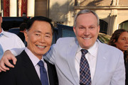 """Actor George Takei and Brad Altman arrive at the Premiere of Universal Pictures' """"Larry Crowne"""" at Grauman's Chinese Theatre on June 27, 2011 in Hollywood, California."""
