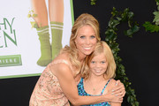 Actress Cheryl Hines and daughter Catherine Rose Young arrive at the premiere of Walt Disney Pictures' 'The Odd Life of Timothy Green' held at the El Capitan Theatre on August 6, 2012 in Hollywood, California.
