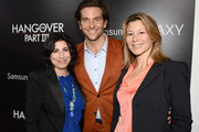 (L-R)  President, Worldwide Marketing Warner Bros. Sue Kroll, Actor Bradley Cooper, and President of International distribution Warner Bros. Veronika Kwan-Rubinek arrive at the premiere of Warner Bros. Pictures' 'The Hangover Part III' on May 20, 2013 in Westwood, California.