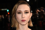 """Taissa Farmiga arrives at the premiere of Warner Bros. Pictures' """"The Mule"""" at the Village Theatre on December 10, 2018 in Los Angeles, California."""