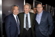 """(L-R) Kevin Tsujihara, Clint Eastwood and Toby Emmerich pose at the premiere of Warner Bros. Pictures' """"The Mule"""" at the Village Theatre on December 10, 2018 in Los Angeles, California."""
