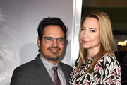 """Michael Pena (L) and his wife Brie Shaffer arrive at the premiere of Warner Bros. Pictures' """"The Mule"""" at the Village Theatre on December 10, 2018 in Los Angeles, California."""