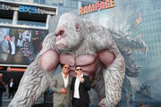 "Dwayne Johnson and director Brad Peyton attend the premiere of Warner Bros. Pictures' ""Rampage"" at Microsoft Theater on April 4, 2018 in Los Angeles, California."