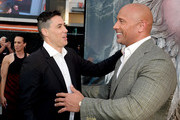 "Director Brad Peyton (L) and actor Dwayne Johnson arrive at the premiere of Warner Bros. Pictures' ""Rampage"" at the Microsoft Theatre on April 4, 2018 in Los Angeles, California."