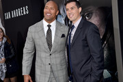 "Actor Dwayne ""The Rock"" Johnson (L) and director Brad Peyton arrive at the premiere of Warner Bros. Pictures' ""San Andreas"" at TCL Chinese Theatre on May 26, 2015 in Hollywood, California."