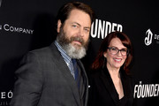 "Actor Nick Offerman (L) and his wife actress Megan Mullally arrive at the premiere of the Weinstein Company's ""The Founder"" at the Cinerama Dome on January 11, 2017 in Los Angeles, California."