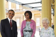 First Lady Michelle Obama (C) and US President Barack Obama are greeted by Queen Elizabeth II as they arrive to Buckingham Palace on May 24, 2011 in London, England. The 44th President of the United States, Barack Obama, and his wife Michelle are in the UK for a two day State Visit at the invitation of HM Queen Elizabeth II. During the trip they will attend a state banquet at Buckingham Palace and the President will address both houses of parliament at Westminster Hall.