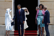 (L-R) Queen Elizabeth II, US President Barack Obama, Camilla, Duchess of Cornwall, Prince Charles, Prince of Wales, First Lady Michelle Obama and Prince Philip, Duke of Edinburgh battle against the wind during a ceremonial welcome in the garden of Buckingham Palace on May 24, 2011 in London, England. The 44th President of the United States, Barack Obama, and his wife Michelle are in the UK for a two day State Visit at the invitation of HM Queen Elizabeth II. During the trip they will attend a state banquet at Buckingham Palace and the President will address both houses of parliament at Westminster Hall.