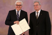 German President Joachim Gauck (R) and Foreign Minister Frank-Walter Steinmeier (SPD) attend a ceremony in which Gauck appointed the new German government cabinet on December 17, 2013 in Berlin, Germany. The new government is a coalition between the German Christian Democrats (CDU), the Bavarian Christian Democrats (CSU) and German Social Democrats (SPD) following federal elections held in September.