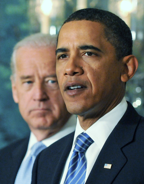 U.S. President Barack Obama speaks about recovery efforts in Haiti from the Diplomatic Reception Room at the White House as Vice President Joe Biden looks on January 14, 2010 in Washington. Obama has pledged an initial relief investment of a 100 million dollars for Haiti.