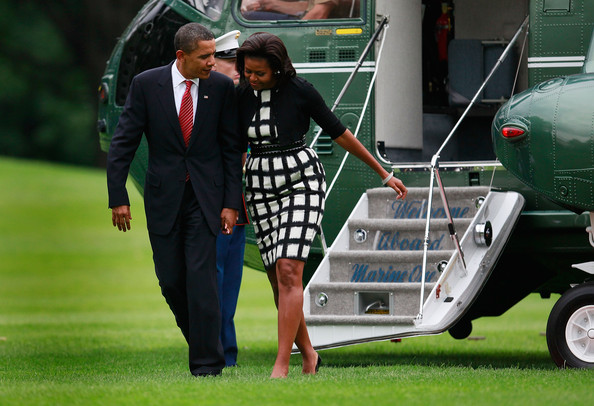 US President Barack Obama and his wife first lady Michelle Obama walk from Marine One on the south lawn after arriving back at the White House on October 2, 2009 in Washington, DC. President Obama later spoke to the media about his trip to Copenhagen to lend support to Chicago to host the 2016 Summer Olympics games which was announced today to be held in Rio de Janeiro instead.