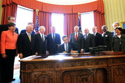 """U.S. President Barack Obama signs H.R. 6156, the Russia and Moldova Jackson-Vanik Repeal and Sergei Magnitsky Rule of Law Accountability Act, into law as (L-R) Sen. Jeanne Shaheen (D-NH), Sen. Ben Cardin (D-MD), Sen. Joseph Lieberman (ID-CT), Sen. Max Baucus (D-MT), House Minority Whip Rep. Steny Hoyer (D-MD), Rep. Sandy Levin (D-MI), Rep. Jim McGovern (D-MA), Rep. Gregory Meeks (D-NY) and  Acting Secretary of the Department of Commerce Rebecca Blank look on during an Oval Office event December 14, 2012 at the White House in Washington, DC. According to a White House news release, the bill """"authorizes the President to extend Russia and Moldova with Permanent Normal Trade Relations and will sanction persons who are responsible for gross violations of human rights in Russia."""""""