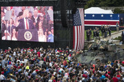 "A screen projects a video feed of President Donald Trump as he delivers remarks during the ""Salute to America"" ceremony in front of the Lincoln Memorial, on July 4, 2019 in Washington, DC. The presentation featured armored vehicles on display, a flyover by Air Force One, and several flyovers by other military aircraft."
