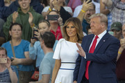 "President Donald Trump and first lady Melania Trump take the stage on July 04, 2019 in Washington, DC. President Trump is holding a ""Salute to America"" celebration on the National Mall on Independence Day this year with musical performances, a military flyover, and fireworks."