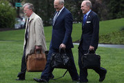 White House Chief of Staff John Kelly (C), walks with National Security Advisor John Bolton (L), and Economic Adviser Larry Kudlow toward Marine One before departing with U.S. President Donald Trump from the South Lawn of the White House on April 16, 2018 in Washington, DC. President Trump is traveling to Hialeah, Florida where he will participate in a small business roundtable discussion on tax cuts.