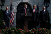 Chairman of the Council of Economic Advisers Kevin Hassett (2nd L) speaks as Director of the United States National Economic Council Larry Kudlow (L) and Vice President Mike Pence (R) listen after U.S. President Donald Trump (3rd L) gave remarks on the economy July 27, 2018 at the South Lawn of the White House in Washington, DC. The U.S. economy grew 4.1% in the second quarter, the fastest pace since 2014.