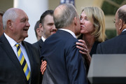 (L-R) Agriculture Secretary Sonny Perdue looks on as Director of the National Economic Council Larry Kudlow kisses U.S. Ambassador to  Canada Kelly Craft before a news conference with President Donald Trump to discuss a revised U.S. trade agreement with Mexico and Canada in the Rose Garden of the White House on October 1, 2018 in Washington, DC. U.S. and Canadian officials announced late Sunday night that a new deal, named the 'U.S.-Mexico-Canada Agreement,' or USMCA, had been reached to replace the 24-year-old North American Free Trade Agreement.