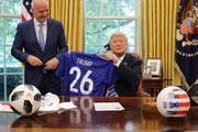U.S. President Donald Trump (R) and FIFA President Gianni Infantino pose for photographs with a soccer uniform in the Oval Office at the White House August 28, 2018 in Washington, DC. The 2026 FIFA World Cup will be jointly hosted by the United States, Canada and Mexico and will be the first World Cup in history to be held in three countries at the same time.