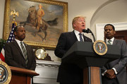 U.S. President Donald Trump speaks while flanked by HUD Secretary Dr. Ben Carson (L) and Isaac Newton Farris, Jr., before signing a proclamation to honor Martin Luther King, Jr. day, in the Roosevelt Room at the White House, on January 12, 2018 in Washington, DC. Monday January 16 is a federal holiday to honor Dr. King and his legacy.