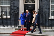 Prime Minister Theresa May and husband Philip May welcome US President Donald Trump and First Lady Melania Trump to 10 Downing Street as Larry the Cat sits on the window ledge, during the second day of his State Visit on June 4, 2019 in London, England. President Trump's three-day state visit began with lunch with the Queen, followed by a State Banquet at Buckingham Palace, whilst today he will attend business meetings with the Prime Minister and the Duke of York, before travelling to Portsmouth to mark the 75th anniversary of the D-Day landings.