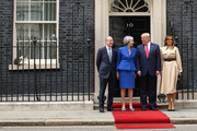 (L-R) Philip May, British Prime Minister Theresa May, US President Donald Trump and First Lady Melania Trump arrive at 10 Downing street as Larry the Cat sits on the window ledge on the second day of the U.S. President and First Lady's three-day State visit on June 4, 2019 in London, England. President Trump's three-day state visit began with lunch with the Queen, followed by a State Banquet at Buckingham Palace, whilst today he will attend business meetings with the Prime Minister and the Duke of York, before travelling to Portsmouth to mark the 75th anniversary of the D-Day landings.