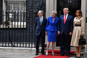 Prime Minister Theresa May and husband Philip May welcome US President Donald Trump and First Lady Melania Trump to 10 Downing Street, during the second day of his State Visit on June 4, 2019 in London, England. President Trump's three-day state visit began with lunch with the Queen, followed by a State Banquet at Buckingham Palace, whilst today he will attend business meetings with the Prime Minister and the Duke of York, before travelling to Portsmouth to mark the 75th anniversary of the D-Day landings.