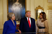 U.S. President Donald Trump (C) and U.S. First Lady Melania Trump (R) view items with British Prime Minister Theresa May (L)  at 10 Downing Street,  during the second day of their state visit on June 4, 2019 in London, England. President Trump's three-day state visit began with lunch with the Queen, followed by a State Banquet at Buckingham Palace, whilst today he will attend business meetings with the Prime Minister and the Duke of York, before travelling to Portsmouth to mark the 75th anniversary of the D-Day landings.