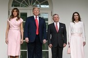 (AFP OUT) U.S. President Donald Trump and first lady Melania Trump greet King Abdullah II and Queen Rania of Jordan on their arrival at the South Portico of the White House on June 25, 2018 in Washington, DC.