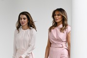 (AFP OUT) First lady Melania Trump (R) and Queen Rania of Jordan walk  the colonnade of the White House on June 25, 2018 in Washington, DC.