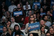 A supporter of Democratic presidential candidate Sen. Bernie Sanders (I-VT) holds a sign during a rally at the University of Minnesotas Williams Arena on November, 3, 2019 in Minneapolis, Minnesota. Sanders was joined at the rally by Democratic Representative Ilhan Omar, who praised the Senator's policy proposals of comprehensive immigration reform and support for unions.