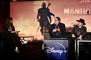 """(L-R) Moderator Ash Crossan, executive producers/writers Jon Favreau and Dave Filoni of Lucasfilm's """"The Mandalorian"""" at the Disney+ Global Press Day on October 19, 2019 in Los Angeles, California. """"The Mandalorian"""" series will stream exclusively on Disney+ when the service launches on November 12."""