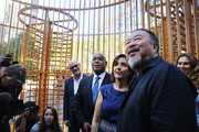 "Chinese activist and artist Ai Weiwei stands in one of his new art installations in Central Park, part of a series of works entitled ""Good Fences Make Good Neighbors"" on October 10, 2017 in New York City. Covering over 300 sites in New York City,  ""Good Fences Make Good Neighbors"" seeks to highlight and start a discussion on the global refugee crisis. The works can be viewed through February 11 in a variety of locations including city parks, bus shelters, newsstands and rooftops.."
