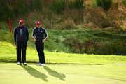 Phil Mickelson (L) and Keegan Bradley of the United States talk on the 9th green during practice ahead of the 2014 Ryder Cup on the PGA Centenary course at the Gleneagles Hotel on September 24, 2014 in Auchterarder, Scotland.