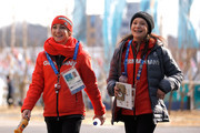 Figure skaters Aljona Savchenko (L) and Annika Hocke of Germany walk through the Athlete Village ahead of the PyeongChang 2018 Winter Olympic Games at Gangneung Olympic Village on February 8, 2018 in Pyeongchang-gun, South Korea.