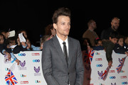 Louis Tomlinson attends the Pride Of Britain awards at the Grosvenor House Hotel on October 31, 2016 in London, England.