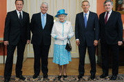 Queen Elizabeth II (C) poses with British Prime Minister David Cameron (L), and former Prime Ministers Sir John Major (2nd from L), Tony Blair (2nd from R) and Gordon Brown (R) at 10 Downing Street on July 24, 2012 in London, England. British Prime Minister David Cameron will host a lunch at Downing Street for Her Majesty The Queen and the Duke of Edinburgh and past Prime Ministers: Sir John Major, Tony Blair and Gordon Brown.