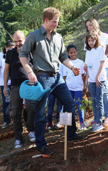 Prince Harry plants a tree as he visits Cota 200, a small village in the Brazilian Atlantic Rainforest on June 25, 2014 in Cota Dos Ventos, Brazil.  Prince Harry is on a four day tour of Brazil that will be followed by Two days in Chile.