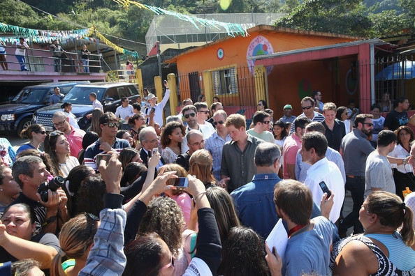 Media and villagers gather around Prince Harry as he visits Cota 200, a small village in the Brazilian Atlantic Rainforest on June 25, 2014 in Cota 200, Brazil.  Prince Harry is on a four day tour of Brazil that will be followed by Two days in Chile.