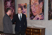 Prince Albert II of Monaco and artist Mark McFadden attend an exhibition by Mark McFadden at HVMC Hotel des Ventes de Monte Carlo on May 15, 2013 in Monaco, Monaco.