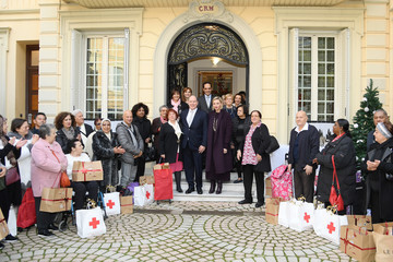 Prince Albert II Princess Charlene Of Monaco attends Christmas Gifts Distribution At La Croix Rouge In Monte-Carlo