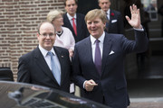 King Willem-Alexander of The Netherlands and Prince Albert II of Monaco (R) leave the Loo Royal Palace on June 3, 2014 in Apeldoorn, Netherlands.