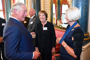 Prince Charles, Prince of Wales speaks to Dame Penelope Wilton and Kate Adie during a reception for Age UK at Buckingham Palace on June 6, 2018 in London, England.