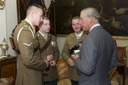 LONDON, ENGLAND  OCTOBER 24:  Prince Charles, Prince of Wales, Colonel-in-Chief of The Royal Dragoon Guards talks to injured dragoons L/Cpl Nick Webb, Cpl David Harmer and Capt Adam Crooksshank who will be taking part in 'In The Footsteps of Legends' South Pole Expedition, made up of servicemen wounded in Afghanistan from the Prince's Regiment, The Royal Dragoon Guards on October 24, 2012 at Clarence House, London.