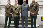 LONDON, ENGLAND  OCTOBER 24:  Prince Charles, Prince of Wales, Colonel-in-Chief of The Royal Dragoon Guards poses for a photograph with injured dragoons L/Cpl Nick Webb, Cpl David Harmer and Capt Adam Crooksshank who will be taking part in 'In The Footsteps of Legends' South Pole Expedition, made up of servicemen wounded in Afghanistan from the Prince's Regiment, The Royal Dragoon Guards on October 24, 2012 at Clarence House, London.