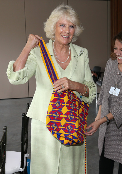 Camilla, Duchess of Cornwall is presented with a traditional Colombian Mochila Bag (made by women who were survivors of Sexual violence) at the Centre for Peace and Reconciliation on October 30, 2014 in Bogota, Colombia. The Royal Couple are on a four day visit to Colombia as part of a Royal tour to Colombia and Mexico. After fifty years of armed conflict in Colombia the theme for the visit is Peace and Reconciliation.