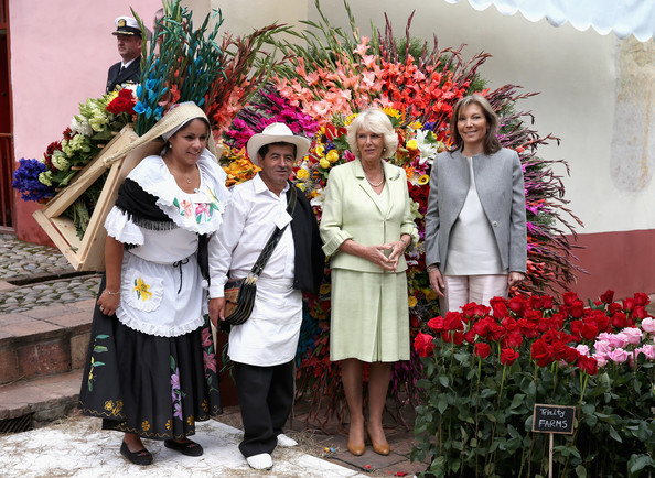 Camilla, Duchess of Cornwall and First Lady of Colombia Maria Clemencia Rodriguez Múneraposes with traditional Colombian Silleteros at the Quinta Bolivar Garden on October 30, 2014 in Bogota, Colombia. The Royal Couple are on a four day visit to Colombia as part of a Royal tour to Colombia and Mexico. After fifty years of armed conflict in Colombia the theme for the visit is Peace and Reconciliation.